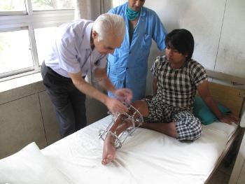2011 Health Honoree Dr. Ashok Banskota examining a patient